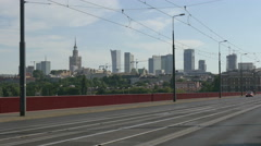 Riding a bike and drivong cars on Silesian-Dabrowski Bridge in Warsaw Stock Footage