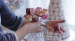 Pretty girl puts on the table sweets Stock Footage
