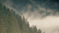 Mountain hills covered with white clowds 2 Stock Footage