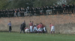 Eton Wall Game St Andrews Day 2015. Oppidans win a penalty advance along wall. - stock footage