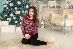 Model on white fluffy carpet - stock photo