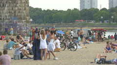 Tourists relaxing at Plaza Miejska, next to Poniatowski Bridge in Warsaw Stock Footage