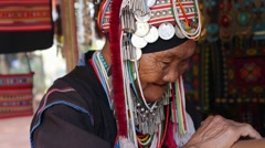 Ethnic Traditional Akha Tribe Elderly Woman from Hill Tribe Minority Village  - stock footage