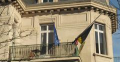 Belgium embassy flag half-mast to pay tribute - stock footage