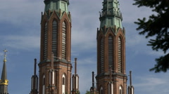Part of two towers capped with bronze spires at St Florian's Cathedral, Warsaw Stock Footage
