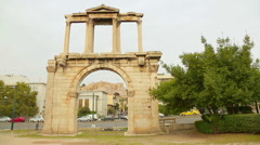 Arch of Hadrian dividing Athens into old and new city, traffic on Amalias Avenue Stock Footage