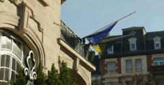 Stock Video Footage of Belgium embassy flag half-mast to pay tribute