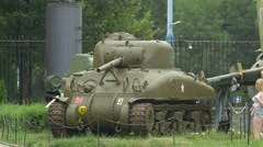 Taking pictures of a military tank at Polish Army Museum, Warsaw Stock Footage