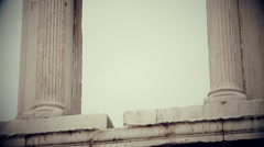 Vertical pan shot of ancient Greek architecture landmark, black and white film Stock Footage