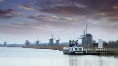 Dutch windmills and dramatic skies at polder Kinderdijk Stock Footage
