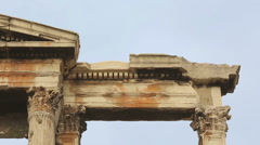 Panorama of destroyed ancient construction, marble Arch of Hadrian in Athens Stock Footage