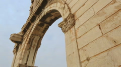 High marble wall of antique Hadrian's Gate in Athens, old historical monument Stock Footage