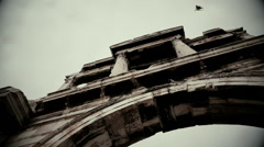 Terrible atmosphere, black bird flying away from scary building, horror film Stock Footage