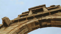View from below at upper level of Hadrian's Gate, ancient arch in Athens, Greece Stock Footage