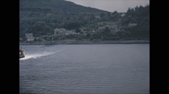 Stock Video Footage of Vintage 16mm film, 1965, Scotland, ferry crosses loch