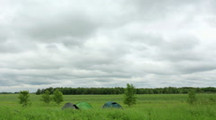 Tourist tents. Movement of clouds over a dirt road. Ishimsky district, Stock Footage