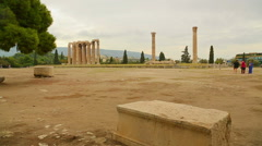 Tourists walking around Temple of Olympian Zeus in Athens, sightseeing tour Stock Footage