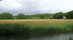 pan Drentse Aa stream meandering through meadows and hayfields - stock footage
