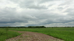 Movement of clouds over a dirt road. Ishimsky district, Tyumen region, Russia,  Stock Footage