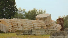Pieces of huge Corinthian column on ground at ancient Zeus temple in Greece Stock Footage
