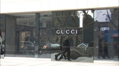 Gucci store, people walking, Shanghai, China Stock Footage
