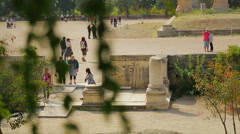 Crowd of people walking, taking pictures at ancient ruins, tourist attraction Stock Footage