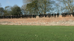 Eton Wall Game St Andrews Day 2015. Extreme wide of supporters pan to match Stock Footage