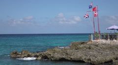 Grand Cayman Island Caribbean flags on beautiful shore 4K Stock Footage