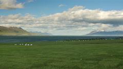 ICELAND Eyjafjoerdur ocean Meer mountain Berg Stock Footage