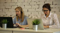 Two customer service representatives at work - stock footage