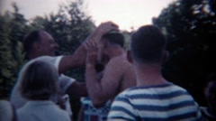 1960: Dad rubbing watermelon on son's head as a coming of age rite of passage. Stock Footage