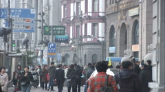 Chinese pedestrians on The Bund, Shanghai Stock Footage