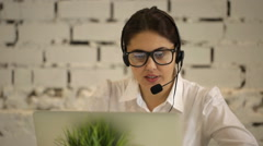 positive girl working in the call center - stock footage