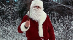 Angry Santa Clause with birch - stock footage