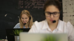 Happy call center operators - stock footage