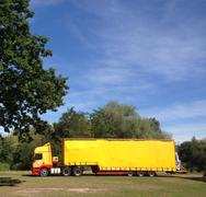 UK, England, London, Yellow truck lorry in rural area Kuvituskuvat