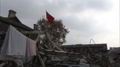 Demolition site, Chinese flag flying Stock Footage