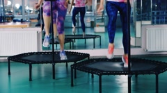 Jumping training together at a fitness studio Stock Footage