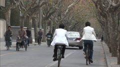 Cyclists in French Concession, Shanghai Stock Footage