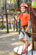 Young boy playing and having fun doing activities outdoors. Happy childhood - stock photo