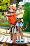 Young boy and girl playing when having fun doing activities outdoors. Happy - stock photo