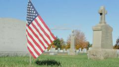 American flag in cemetery during autumn Stock Footage