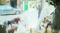 4K Happy smiling couple looking in the window of small boutique shop.  Stock Footage