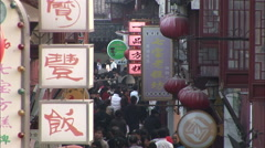 Crowded backstreet, Chinese signs, lanterns Stock Footage
