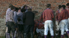 Eton Wall Game St Andrews Day 2015. Collegers win penalty advance along wall. - stock footage