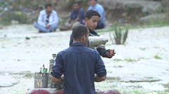 Boy selling tea on the road side in Lebanon. Stock Footage