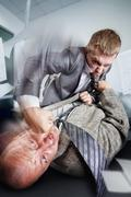 Business fight in the office - stock photo