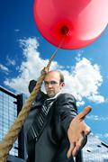 Businessman inviting you to fly up Stock Photos