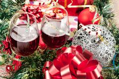 Stock Photo of Holiday gifts and wine glasses