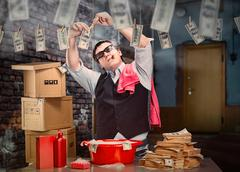 Businessman is laundering money in the basement - stock photo